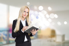 Businesswoman with journal Stock Image