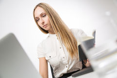Businesswoman with journal Royalty Free Stock Photos