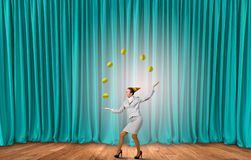Businesswoman juggling with balls Royalty Free Stock Image