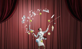 Businesswoman juggling with balls Stock Photo