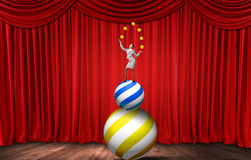 Businesswoman juggling with balls Royalty Free Stock Photo