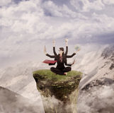 Businesswoman juggling multi tasks by nature. Businesswoman is juggling many tasks on top of a mountain Stock Image