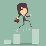 Businesswoman Jump Through The Gap In Growth Chart Stock Images