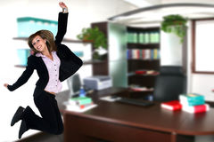 Businesswoman jump in office Stock Photo