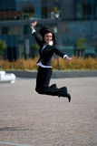 Businesswoman jump outdoors Royalty Free Stock Photo