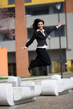 Businesswoman jump outdoors Stock Photo
