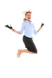 Businesswoman jumping. With shoes in hand Royalty Free Stock Images
