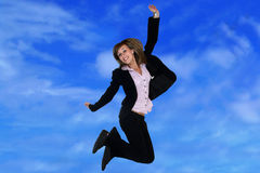 Businesswoman jumping. With sky background Royalty Free Stock Image