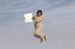 Businesswoman Jumping With Blank Sign Royalty Free Stock Image