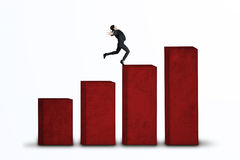 Businesswoman jumping on business chart isolated Stock Photography