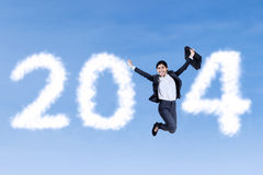 Businesswoman jumping with 2014 Royalty Free Stock Images