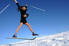 Businesswoman jumping on ski Stock Photos