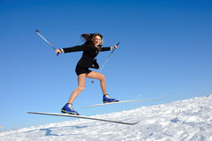 Businesswoman jumping on ski Stock Photo