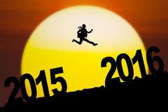 Businesswoman jumping toward 2016 numbers Royalty Free Stock Photography
