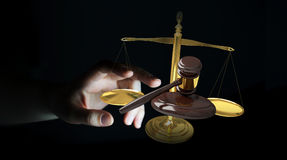 Businesswoman with justice hammer and weighing scales 3D renderi. Businesswoman on blurred background with justice hammer and weighing scales 3D rendering Stock Images
