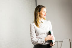 Businesswoman keeping folder. Concept of leadership and success. Stock Image