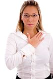 Businesswoman keeping hand on her chest Royalty Free Stock Photos