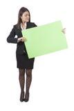 Businesswoman keeping signboard Stock Photo