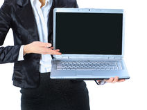 Businesswoman keeps the laptop. Stock Photography