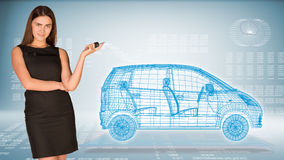 Businesswoman with key and wire frame car Royalty Free Stock Image