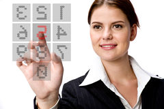Businesswoman and Keypad. A young businesswoman typing on a transparent keypad on screen Royalty Free Stock Photo