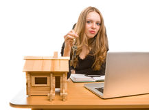 Businesswoman with keys and toy house at office Royalty Free Stock Image