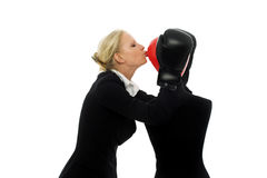 Businesswoman kissing a dummy Royalty Free Stock Images