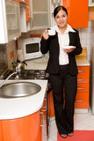 Businesswoman in kitchen Stock Images