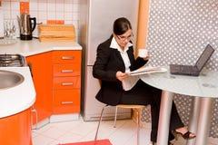 Businesswoman in kitchen Stock Image