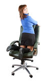 Businesswoman  kneeling on chair Stock Photography
