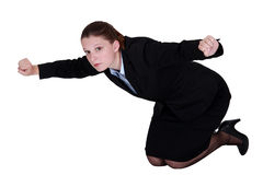 Businesswoman kneeling on the floor Stock Image