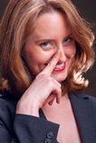 Businesswoman with knowing look Royalty Free Stock Photography