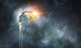 Businesswoman on ladder Royalty Free Stock Photography