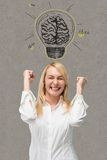 Businesswoman with lamp. Happy businesswoman with lamp over head Stock Photography