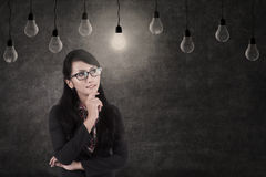 Businesswoman and lamps, symbol of idea Royalty Free Stock Photography