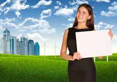 Businesswoman with landscape and skyscrapers Stock Image