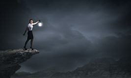 Businesswoman with lantern Stock Image