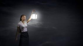 Businesswoman with lantern Royalty Free Stock Image