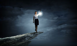 Businesswoman with lantern Stock Photography