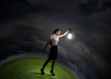 Businesswoman with lantern Royalty Free Stock Images
