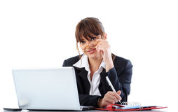 Businesswoman with laptop. Happy young businesswoman at desk with open laptop computer; white studio background Stock Photography