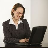 Businesswoman with laptop. Royalty Free Stock Photo