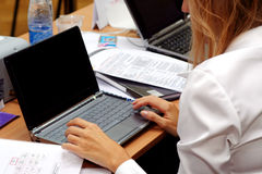 Businesswoman with laptop. Businesswoman working on the laptop at the seminar Royalty Free Stock Image