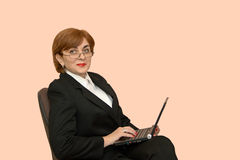 Businesswoman with a laptop Stock Image