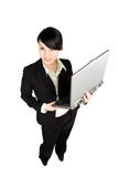 Businesswoman and laptop Royalty Free Stock Images