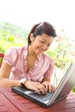 Businesswoman on laptop Stock Photography