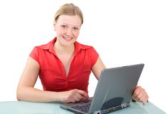 Businesswoman with Laptop. Young attractive businesswoman with laptop at her desk Isolated white background royalty free stock image