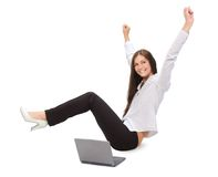 Businesswoman with laptop. Young businesswoman with laptop with her hands up Stock Photo