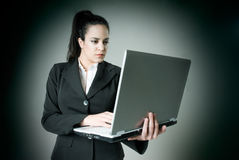 Businesswoman with laptop. Businesswoman working with her laptop Royalty Free Stock Image