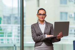The businesswoman with laptop in business concept Stock Photo